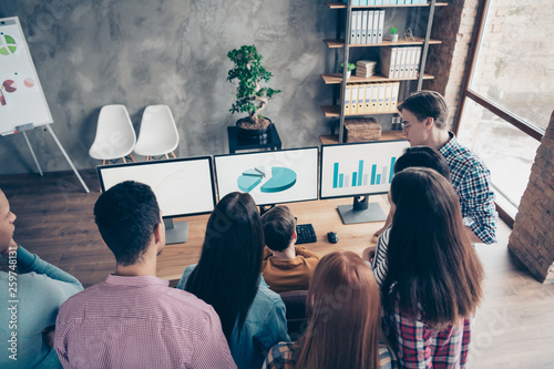 Fototapeta Top above high angle view of nice stylish busy smart clever experts wearing casual analyzing making research company growth progress sales plan at industrial loft interior workplace workstation obraz
