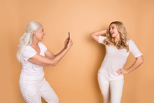 Portrait Of Nice-looking Lovely Adorable Slender Attractive Charming Cute Cheerful Ladies Wearing White T-shirt Outfit Taking Making New Snap Shot Photo Picture Isolated On Beige Pastel Background