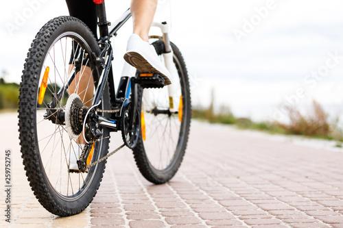Fototapeta Young woman cycling