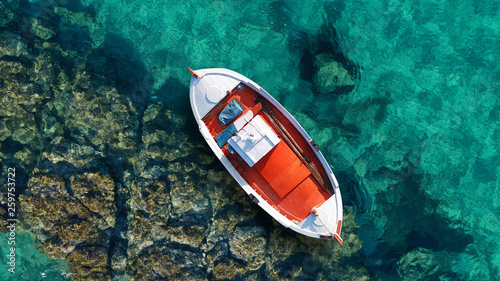 Montage in der Fensternische Santorini Aerial photo from traditional picturesque fishing boat on turquoise clear sea as seen from top in island of Paros, Cyclades, Greece