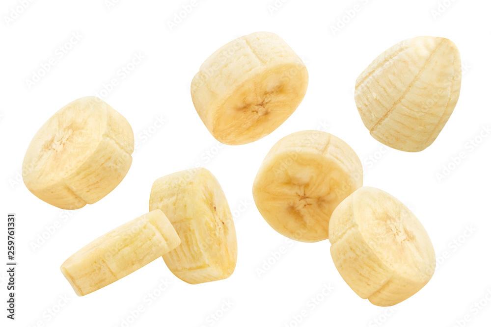 Fotografie, Obraz Flying banana slices, isolated on white background