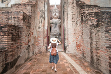 Tourist Woman Is Travel In Wat Si Chum In Sukhothai Historical Park In Thailand.
