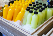 Bottles Of Fresh Juice In A Wo...