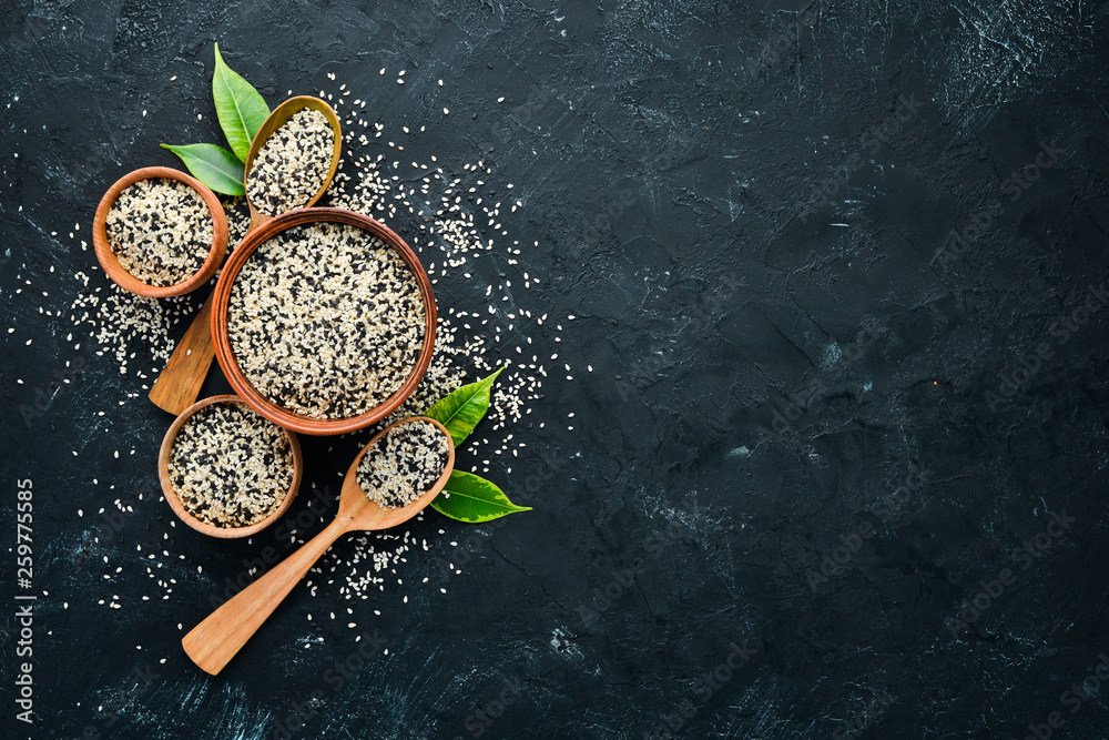 Fototapety, obrazy: Sesame. Set of black and white sesame seeds. On a black background. Top view. Free copy space.