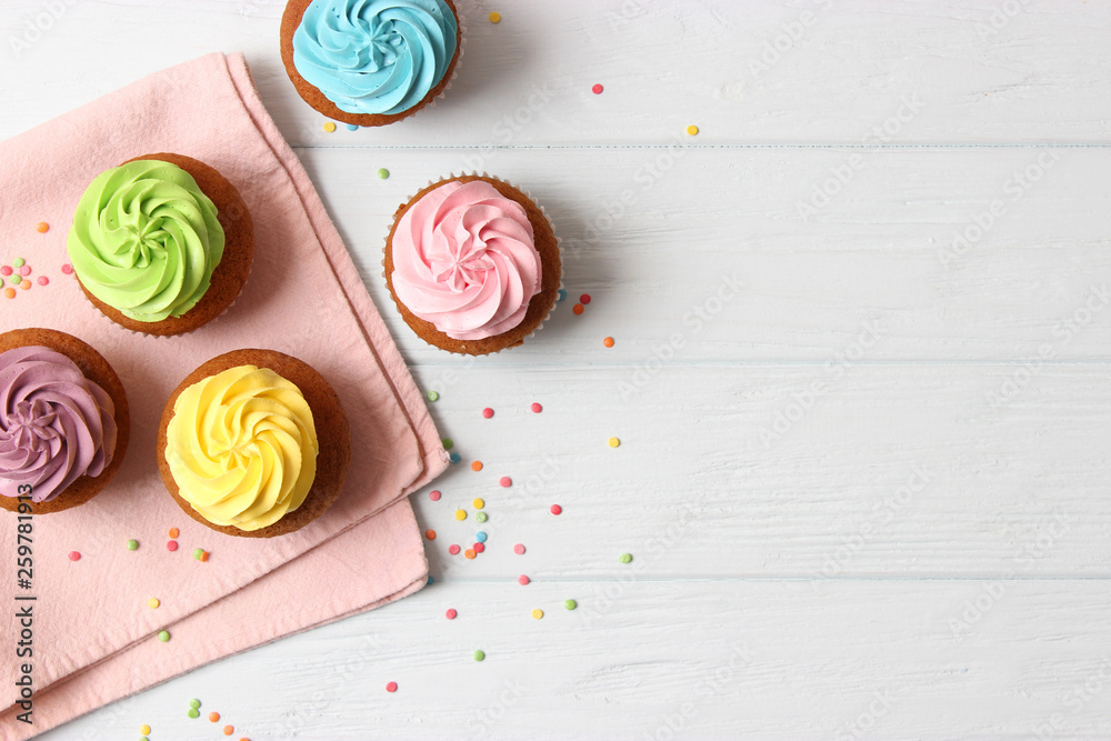 Fototapety, obrazy: Tasty cupcakes on the wooden table.