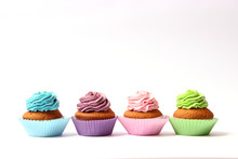 Tasty Cupcakes On A White Background.