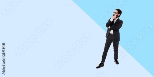 Valokuvatapetti full length portrait of  thinking bearded businessman, panoramic photo with copy