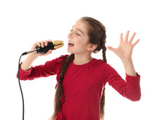 Cute Girl Singing In Microphone On White Background