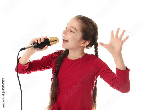 Fotografie, Obraz Cute girl singing in microphone on white background