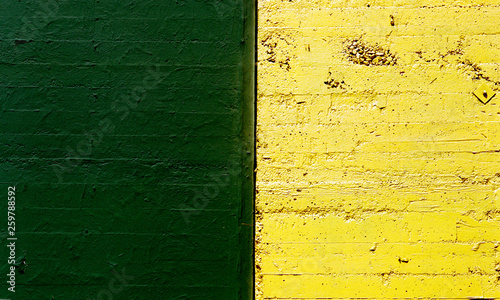 green and yellow textured concrete wall