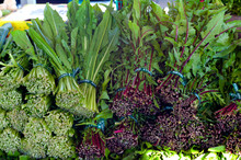 Bunches Of Green And Red Dandelion At Farmer's Market