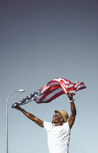 Happy Black Man With Flying American Flag