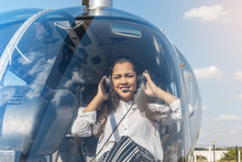 Young Smiling Woman Helicopter...