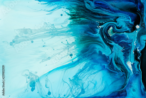 Foto auf AluDibond Kristalle Abstract flow of liquid paints in mix