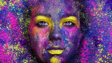 Young Pretty Girl With Colorful Creative Make-up On Holi Powder Background
