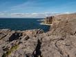 Rock formations in County Clare, Ireland, Blue water of the Atlantic ocean, Mini Cliffs. Part of Wild Atlantic Way.