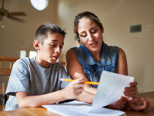 Tela mother helping son with homework