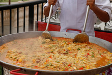 Chef Cooking Spanish Paella In...