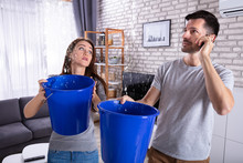 Couple Using Bucket For Collec...