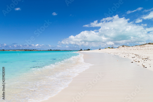 Gorgeous white sand beach and blue sky on Turks and Caicos Islands.