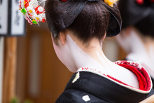 A Traditional Geisha Out And About Walking In Gion Kyoto Japan .