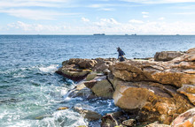 Rocky Sea Coast With Fishermen Landscape