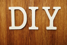 D.I.Y. Word Alphabet Letters On Wooden Background