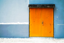 Two Big Old Barn Door With Concrete Wall Background Texture. Old Big Orange Color Gate With Concrete Wall Texture Surface