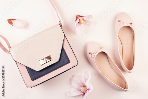 Nude colored ballerina shoes and magnolia flowers. Fototapete