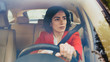 canvas print picture - Portrait of Serious Beautiful Young Woman Driving Car through Sunny Suburban Area. Camera Shot Made From the Front Windshield.