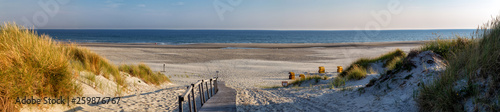 Spoed Fotobehang Strand Beach on the East Frisian Island Juist in the North Sea, Germany, in morning light.