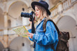 Young woman, professional photographer with camera in old castle