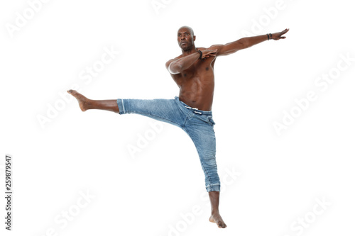 Fotografía  Athletic young black man in jeans and with a nude torso dancing isolated on white background