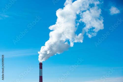 Leinwand Poster From brick round chimney smoke comes
