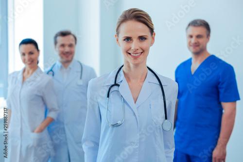 Fotografía Positive delighted doctor posing on camera