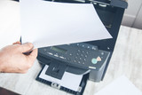 worker man with xerox in office - 259889166