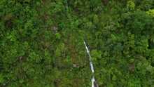 Aerial Drone Flying In Slow Motion Over A Green Forest Around A Cliff Waterfall In The Andes Mountains, Peru.