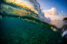 Ocean Wave Breaking Over The Reef At Sunset
