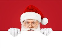 Santa Claus Holds A Blank Sign For Your Text
