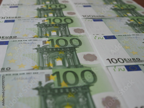 Photo  new 100 Euro banknotes are neatly arranged in rows