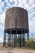 Rundown, Rusty Water Tower Along Abandoned Railroad Tracks.