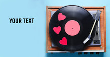 Retro Culture, Valentine's Day. Decorative Hearts On A Vinyl Record Plate On Blue Background. Top View, Minimalism. Copy Space