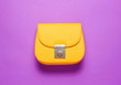 canvas print picture - Yellow leather mini bag on purple background. Minimalism fashion concept. Top view