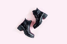 Black Female Boots On Pink Bac...