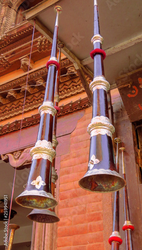 Poster Muziekwinkel Tibetan horn hanging from the ceiling in front of a music store in Bhaktapur, Nepal