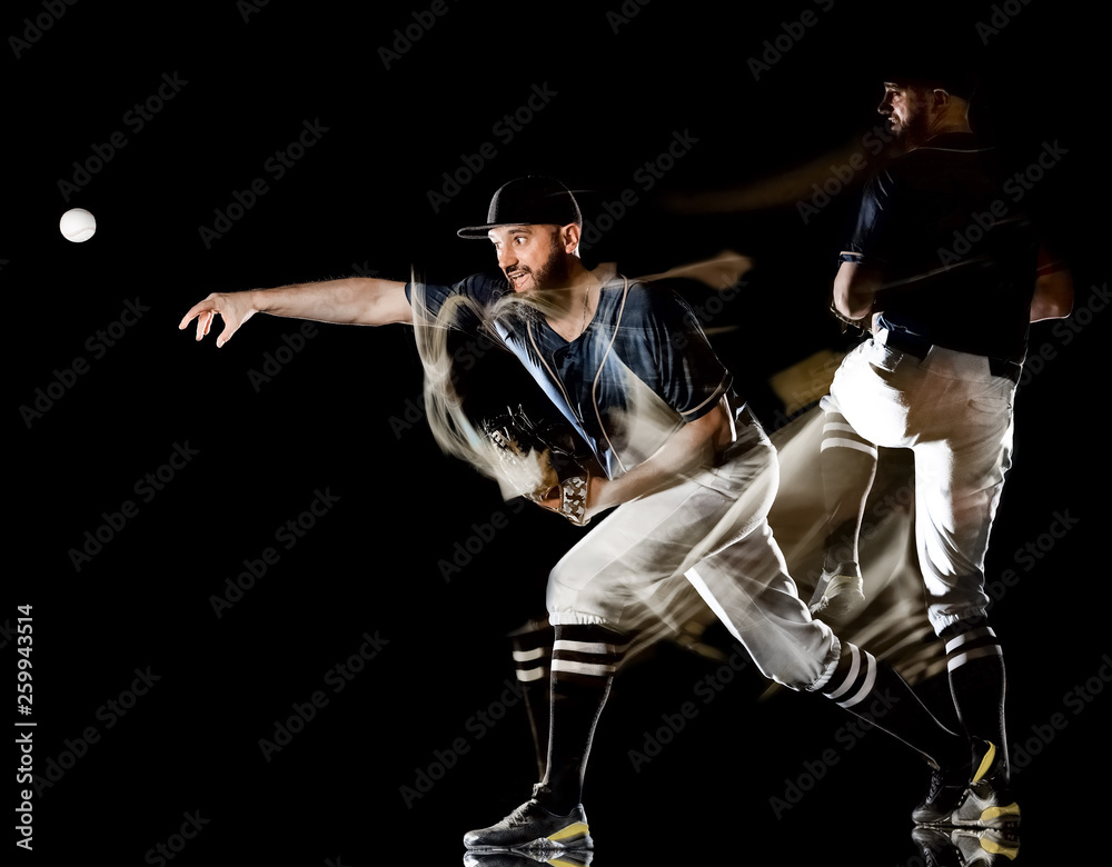 Fototapety, obrazy: one caucasian baseball player man  studio shot isolated on black background with light painting speed effect