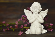 Guardian Angel Kneeling And Praying