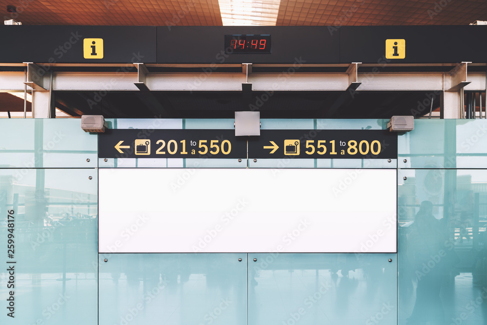 Fototapeta Blank electronic departures and arrival information billboard with clean space for publicity content or a text message, an indoor advertising placeholder mock-up; a public board in an airport terminal