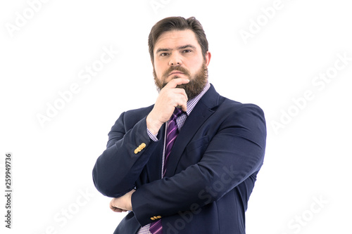 Fototapeta  Portrait of a big handsome pensive bearded business man in a dark suit and a bri