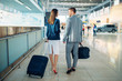 Business class passengers with luggage in airport
